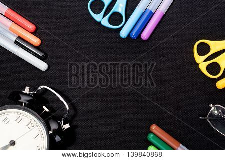 School supplies on blsck background ready for your design