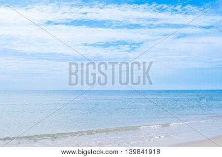 A sea wave and blue sky with cloud