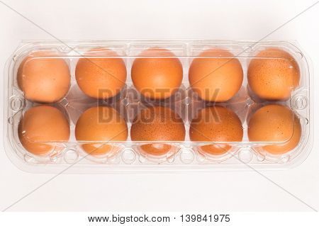 Transparent Egg Box with eggs in white background