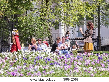 St. Petersburg, Russia - 9 May, People resting in the garden, 9 May, 2016. Vacationers people on the lawns and gardens in the city.