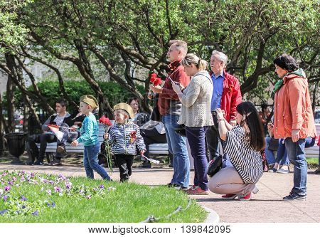 St. Petersburg, Russia - 9 May, People of different ages, 9 May, 2016. Vacationers people on the lawns and gardens in the city.