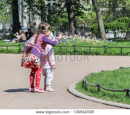 St. Petersburg, Russia - 9 May, Children in flower beds, 9 May, 2016. Vacationers people on the lawns and gardens in the city.