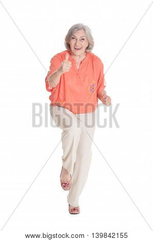 beautiful senior woman with thumb up on white background