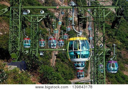 Hong Kong China - January 2 2008: An enormous cable car system with hundreds of gondolas transports visitors from the lowlands to the headlands stations at Ocean Park
