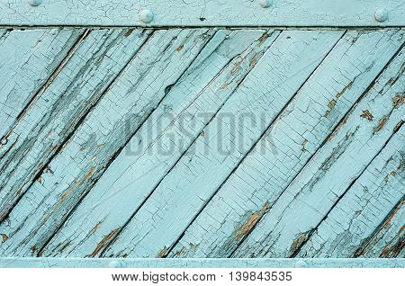 Vintage wooden planks covered with blue paint