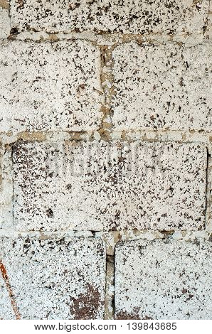 Old wall made of concrete blocks covered with plaster