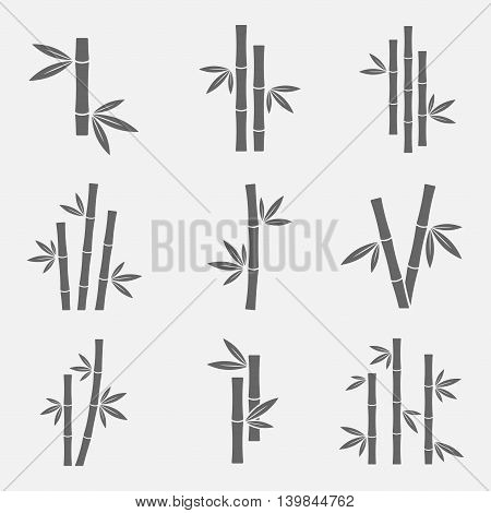 Bamboo icons vector set isolated on a light background. Black sign of bamboo stems with leaves in a flat style. Simple silhouettes bamboo forest jungle or trees.