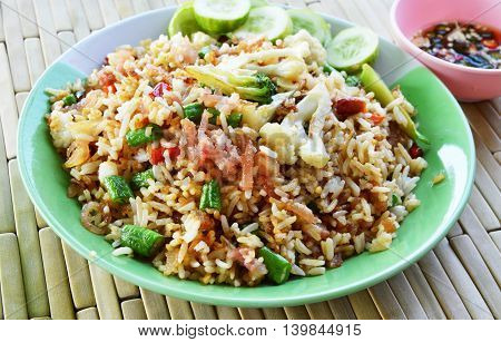 fried rice with sour pork and vegetable on dish