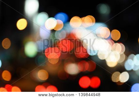 Abstact Multicolored defocused round bokeh at urban night