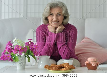 portrait of happy Senior woman with tea at home