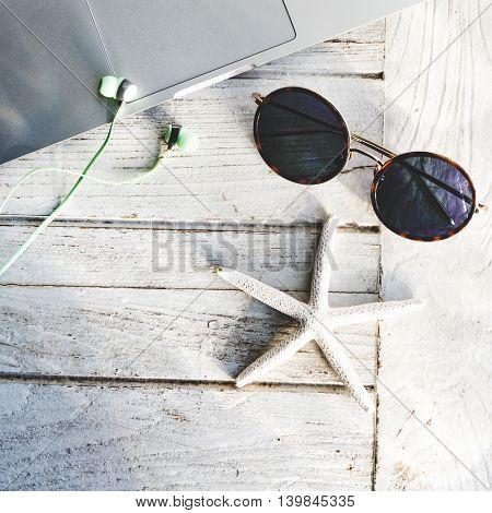 Laptop Sunglasses Seashell Concept