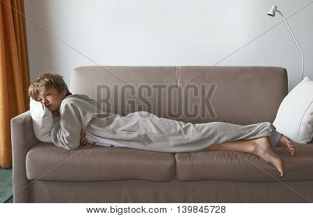 Boy Watch Television Program On Sofa