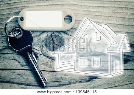 key on the wood background to buy a house