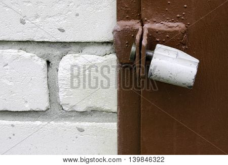 Iron lock on a door brick wall
