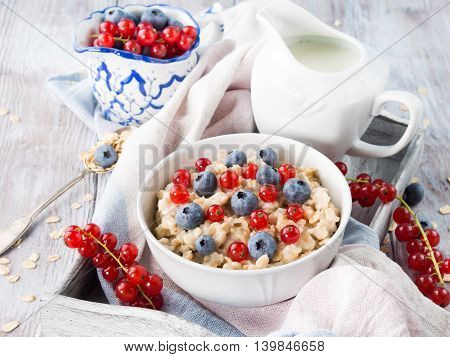 Oatmeal Porridge With Blueberries And Red Currants