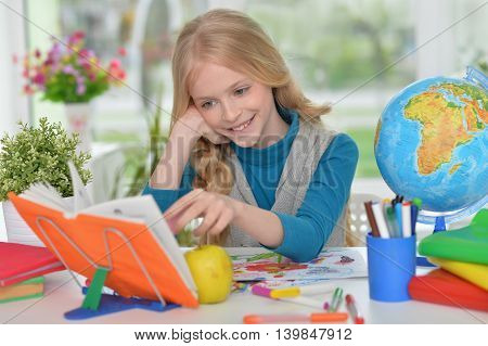 Cute  student girl  with book at class
