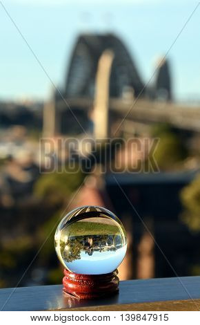 Close-Up Of Marble With Sydney Harbour Bridge Reflection at Observatory Hill