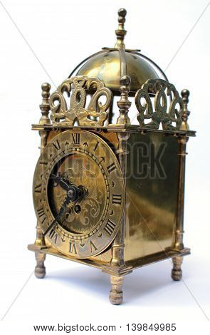 Very Ornate Brass Carriage Clock on white background