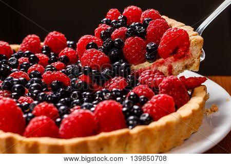 beautiful fruit pie tart currant and raspberries