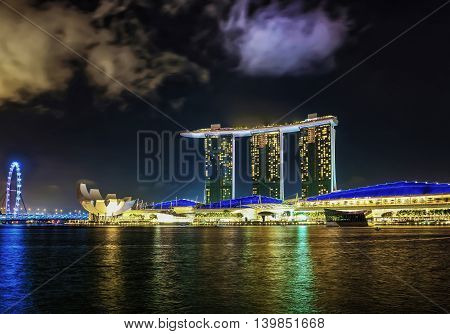 Singapore Flyer And Artscience Museum And Marina Bay Sands Dusk