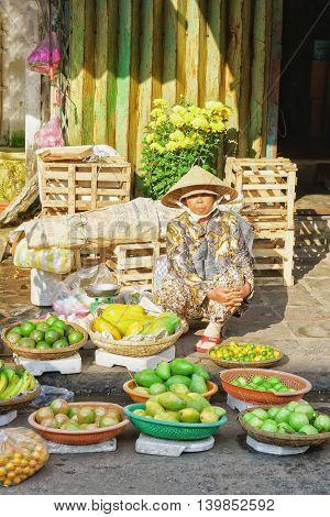 Asian Trader Selling Fresh Banana Mango And Lime