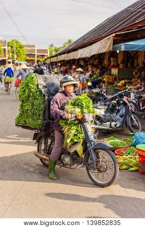 Asian Woman Buyer Or Seller In Motor Bicycle With Salading