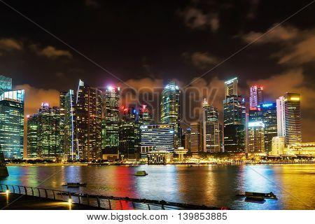 Singapore Skyline Of Downtown Core At Marina Bay At Night