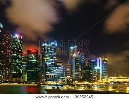 Singapore Skyline Of Downtown Core On Marina Bay At Dusk