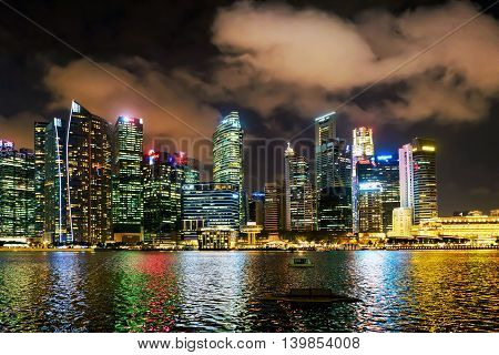 Singapore Skyline On Downtown Core At Marina Bay At Twilight