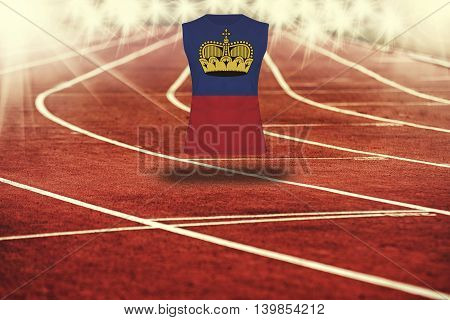 red running track with lines and Lichtenstein flag on shirt
