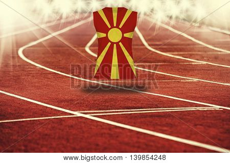 Red Running Track With Lines And Macedonia Flag On Shirt