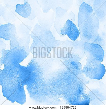 Blue abstract watercolor background with stains