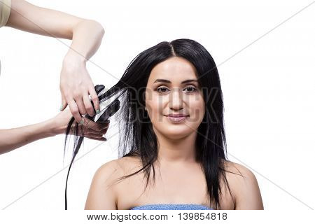 Young woman getting hair straightner isolated on white
