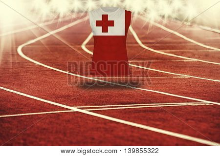 Red Running Track With Lines And Tonga Flag On Shirt