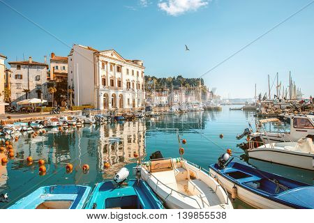 View on marina with boats and buoys in Piran town in southwestern Slovenia