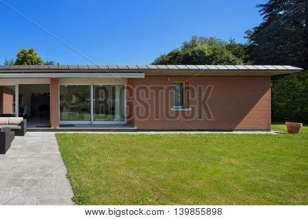 Architecture, veranda of a brick house, outdoors
