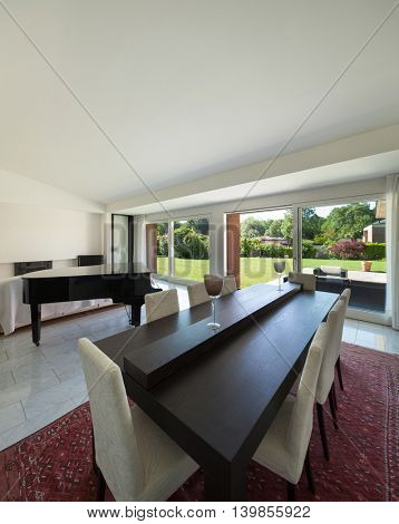 Dining room with piano of a modern house, interior