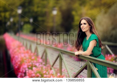 Happy Melancholic Woman on a Bridge with Flowers