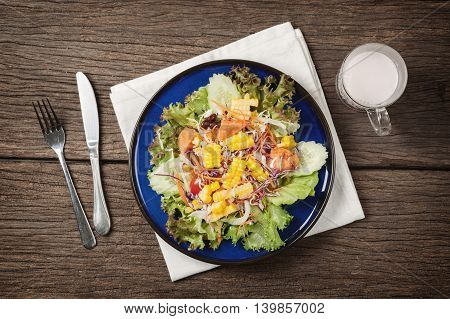 healthy food, fresh salad on wooden table