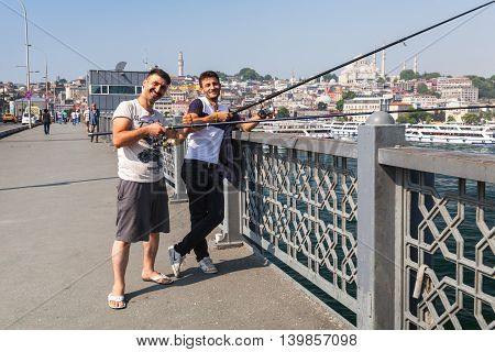 Smiling Young Adult Fishermen On Galata Bridge
