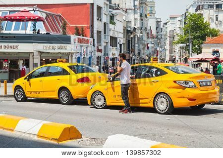 Taxi Driver Near Yellow Cars On Taksim Square