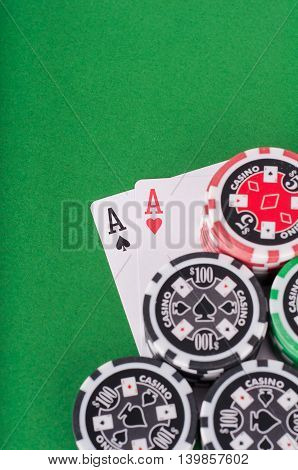 Pair Of Aces, Red And Black Cassino Chips On Green Table