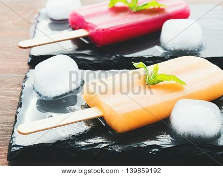 Fruit Popsicles On Black Slate Plates
