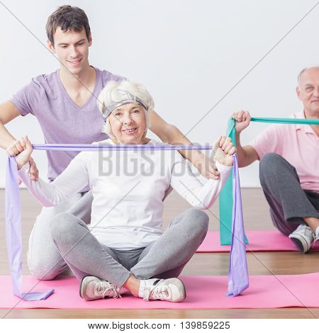 Mature Couple With Personal Trainer