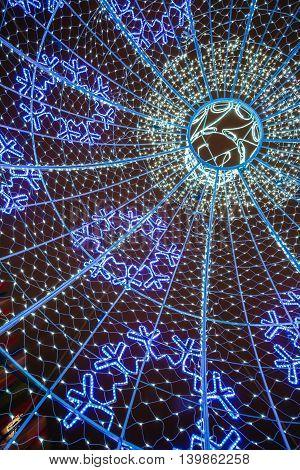 City Christmas illuminations decorations background Winter Evening