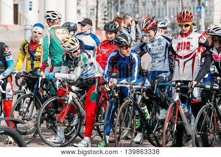 Gomel, Belarus - April 10, 2015: Group of young people cyclists in sportswear for cycling at opening of the cycling season in the city
