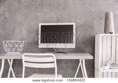 White minimalist place to work with concrete wall