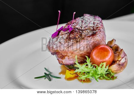 Organic delicious beef steak on white plate. Shallow dof