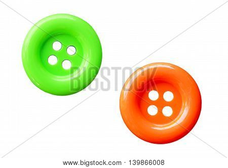 Close-up colorful sewing buttons isolated on white background.