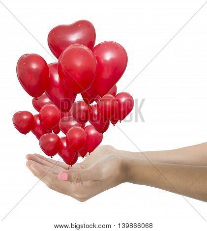Woman hands giving a group red balloons